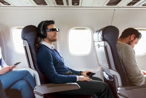 Epson Moverio AR glasses used by a traveler on an airplane for privacy
